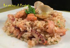 Risotto alla pescatora un primo piatto di mare buonissimo e dal sapore unico. Il riso esalta tutto il sapore del mare. Provatelo.