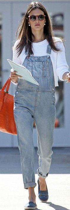 Who made Alessandra Ambrosios white sweater, blue denim overalls, and orange handbag?