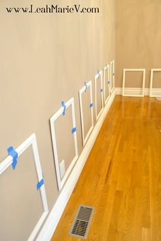 DIY picture frame molding tutorial. This one is done from pre-made picture frame moldings from Lowes or Home Depot. Would be way easy!