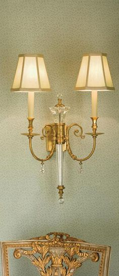 brass solid crystal sconce with carved occasional chair