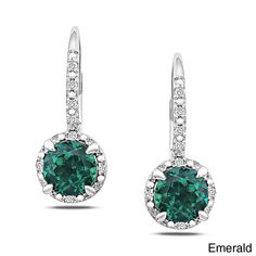 These sterling silver earrings features single round gemstones in your choice of created emerald, garnet, peridot, mystic topaz, aquamarine, opal, amethyst, green amethyst or blue topaz options accentuated by diamonds.