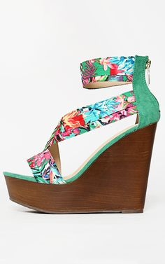 The perfect tropical floral wedge. Love the wooden heel. | MakeMeChic.com