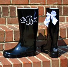 EASY and super cute diy project! order rainboot decal for intials and hot glue the bows on the back.