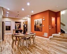 Fabulous Burnt Orange Paint Colors Room Will Makes Lively Your Rooms: Cool Burnt Orange Paint Colors With Wooden Round Dining Table With Candle Above It And Wooden Steps ~ wzfjsh.com Wall Decor Inspiration