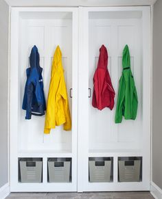 Best mudroom ever! Handles open on piano hinges to storage behind! traditional closet by Cory Connor Designs