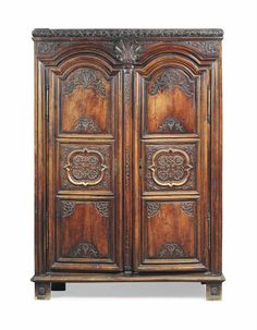 A FRENCH WALNUT ARMOIRE LATE 18TH CENTURY