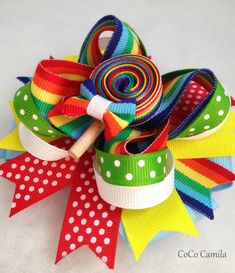 Rainbow lollipop Over the top hair bow clip girl toddler birthday. $10.00, via Etsy.