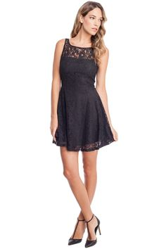This feminine dress features a lace overlay.