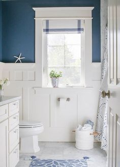 Pretty And Fresh Navy White Coastal Inspired Bathroom Finished With Carrara Marble Board Batten Wainscoting