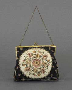 Black needlepoint purse in floral motif. Brass-coloured closure and looped chain handle, c.1930s. FRC1989.04.019