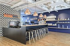 office interior  by idstudio  coffeebar with stools from Hay and lamps from Hem