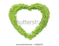 Powdered matcha green tea in heart shape, isolated on white - Shutterstock Premier