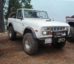 Nice White Early Bronco with the top off and ready for the beach!