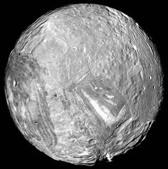 "Miranda, moon of Uranus. The surface is probably mostly water ice, rather like some of the moons of other outer planets.  But it's a jumble of older and younger surfaces, large canyons, broken terrain and other evidence of past geological activity. Mona Evans, ""Literary Moons of Uranus"" http://www.bellaonline.com/articles/art181335.asp"