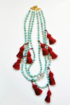LOVE the tassels on this necklace. I mean - better on the necklace than somewhere else...? Maybe? :-P