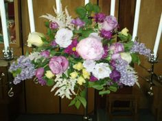 Flowers for the candelabras - pink peony, yellow roses, lilacs, astillbe, lavender roses