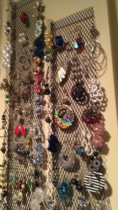 Need a way to store earrings?  Here's what I did.  Looked around in the garage for a couple of unused gutter guards, attached them to my closet wall using stick-on Velcro and ta da!!  Easy storage/view.