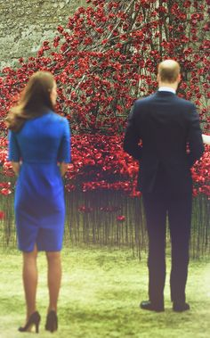 The Duke and Duchess of Cambridge view ceramic poppies at the Tower Of London's Ceramic Poppy installation 'Blood Swept Lands and Seas of Red' which commemorates the 100 years since the outbreak of World War I.