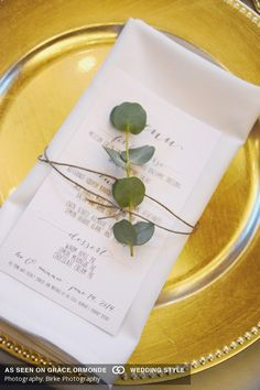 white menu with eucalyptus leaves and twine