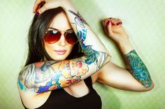 Go look her blog! All about tattoos <3   http://ohhmymy.com/beautiful-tattoos-turn-worlds-eye-on-you/