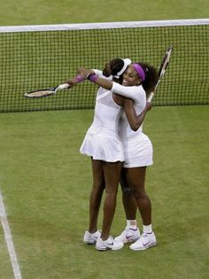 Sister LOVE: Venus Williams and Serena Williams of the United States react after defeating Andrea Hlavackova and Lucie Hradecka of the Czech Republic in the women's doubles final match at the All England Lawn Tennis Championships at Wimbledon, England, Saturday, July 7, 2012