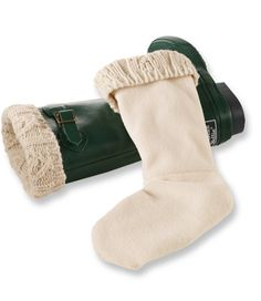 "<p>Add extra warmth and flair to rain boots with our warm fleece liners. Cuff folds over the top of the boot to keep the warmers from sliding down. Turn inside out before using – designed to be worn with the seams on the outside. Polyester. Acrylic-blend knit cuff. 11""H. Imported. Machine wash and dry.</p>"