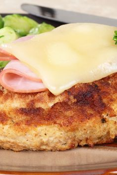 Copycat Sizzler Malibu Chicken Recipe - Breaded boneless, skinless chicken breasts topped with ham and Swiss cheese and a creamy mustard dipping sauce.