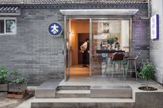 Chinese Office AIO has converted a 34 sqm building in Beijing's Xiang'er Hutong into a tiny coffee bar that also offers a cosy bedroom for its guests. Small Coffee Shop, Big Coffee, Coffee Shops, Internal Courtyard, Cosy Bedroom, Big And Small, Beijing China, Tiny Spaces, Timber Flooring
