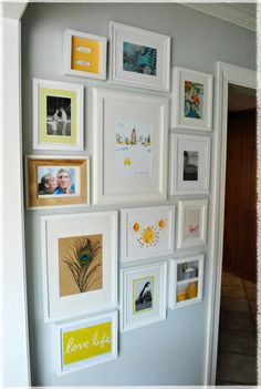 Words, prints, and personal images in white frames creates an eclectic yet pulled together display.