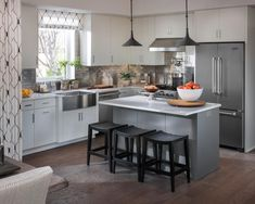 The heart of the home is the kitchen! Designer Linda Woodrum kept a triangular style in mind when designing the layout of this modern farmhouse style kitchen --> http://www.hgtv.com/design/hgtv-smart-home/2015/kitchen-pictures-from-hgtv-smart-home-2015-pictures?soc=smartpin