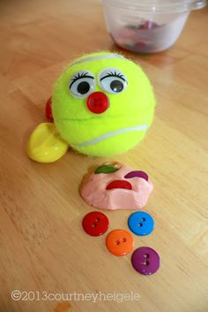 """Pull the Buttons Out of the Theraputty, then """"Feed"""" Then to the Tennis Ball"""