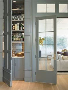 Multidisciplinary design firm Hoedemaker Pfeiffer updated this 1990s house with equal sensitivity toward the interiors and the landscape. In the den, a hidden closet houses a discreet bar cabinet   archdigest.com