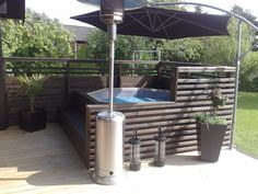 Good idea - shade small pool or spa area with an umbrella (which appears to be set in the concrete) Hot Tub Gazebo, Hot Tub Backyard, Hot Tub Garden, Backyard Pool Landscaping, Hot Tub Deck, Backyard Patio Designs, Jacuzzi Outdoor, Outdoor Spa, Tub Enclosures