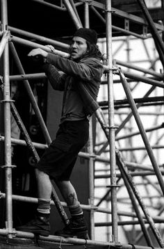 Eddie Vedder climbs the stage scaffolding during Pearl Jam's performance at the Pinkpop festival in Landgraaf, Netherlands on June 8th 1992.