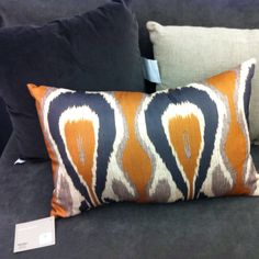 Mustard and dark gray ikat accent pillow...for master bedroom to go with red velvet pillow shams.  Cost Plus.