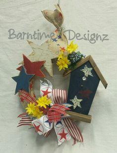 Sweet stars & stripes. .burlap wreath with rustic stars & patriotic bird house. Info@barntimedesignz.com $39. #050315btd.