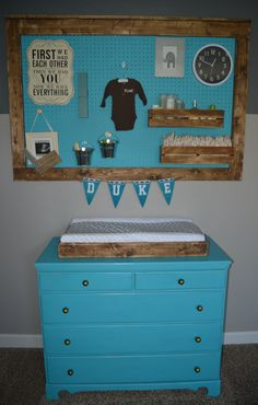 A gray and white DIY boys nursery with turquoise as an accent color.