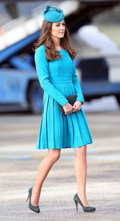Kate rules the runway as she walks across the tarmac at Dunedin International Airport in New Zealand. Created by New Zealand-born, London-based designer Emilia Wickstead, the aquamarine dress compliments the Duchess' enviable figure and golden skin tone.Milliner Jane Taylor ensured that her hat matched the dress perfectly.