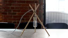 Surprisingly stylish lamp from 3 sticks and a light bulb