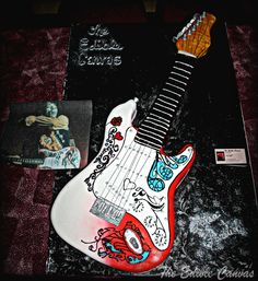 https://www.facebook.com/photo.php?fbid=10150605613700753    Jimi Hendrix Monterey Pop Festival Guitar    Life size, Jr. Stratocaster.     Hand carved/painted Dark Chocolate cake w/vanilla buttercream and fondant. The red is airbrushed. All hardware is edible except for the strings.     Donated to the Rock for Life; A Renal Benefit 3/10/12 for Dan Scott Whitcomb at Sidelines, The Local in Marietta.    View more cake art at: www.facebook.com/theediblecanvas