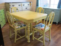 Hmm my kitchen table might get a face lift :) Yellow painted table and chairs