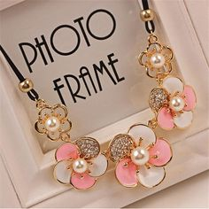 Min. order $10 . Free shipping! Imitation rhinestone gem pearl DAISY rose flower statement necklace summer style diomand from Gonayiv.