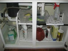 Under sink shelf organizer can provide shelving to get you more space, but also keep things more organized {featured on Home Storage Solutions 101}