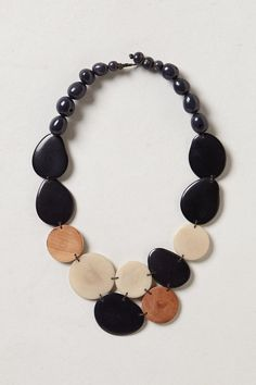 I'm in love with Tagua jewelry, especially necklaces. Hammered Tagua Necklace - anthropologie.com