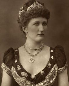 Taking styling tips from Lady Julia Carew circa 1888, I love the way she has embellished the entire neckline of her dress with brooches!