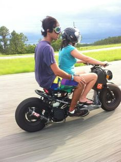 Hitching a ride. This is what my Honda Ruckus Zoomer would look like!
