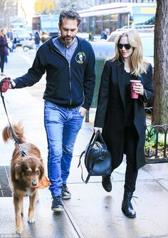 Just walking the dog: Amanda Seyfried and fiance Thomas Sadoski, who are expecting their first child, were spotted out with Australian Shepherd Finn in New York on Thursday