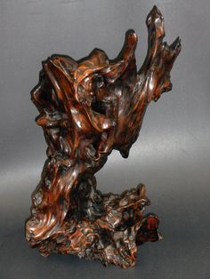 An old and large natural root-wood sculpture.