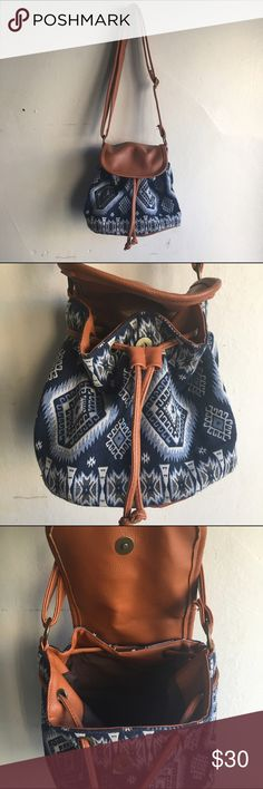 CLOSET CLEAR-OUT Tribal Bucket Bag Bucket bag with tribal print. Drawstring and magnetic button close. Flat bottom. Adjustable strap. Bag is in perfect condition and was Only used a couple of times. Small but spacious. Additional pocket inside zips close. #K186 Bags Mini Bags