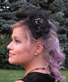 Gorgeous black teardrop fascinator. Silk flowers, feathers & Russian veil with glittery beads & faux diamonds. Stunning for a special guest or a dramatic bride. $120